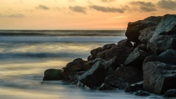 The rocks at Dog Beach in San Diego at sunset.
